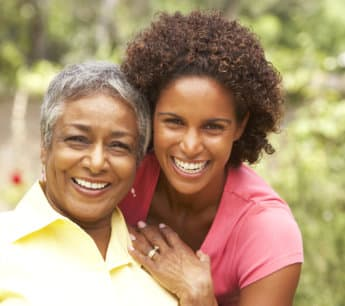 caregiver and elderly woman smiling